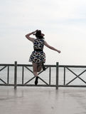 Fashion Asian Woman Jumping at Seaside Stock Images