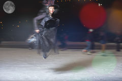 Fashion asian woman like witch flying above ice rink Stock Photos