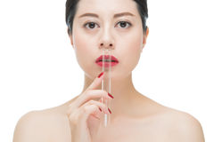 Fashion asian woman red lips nail and kiss lab tube. Fashion asian woman red lips nail and holding chemistry test lab tube, isolated on white background Stock Photo