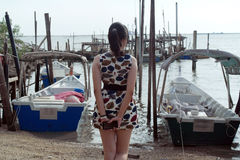 Fashion Asian Woman Standing on Beach Watching Sea View Royalty Free Stock Photography