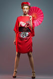 Fashion asian woman wearing traditional japanese red kimono   Stock Photos