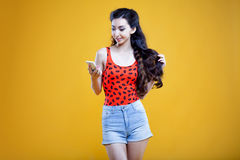 Fashion asian young  girl with mobile phone, in Royalty Free Stock Photo