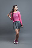 Fashion asian young  girl. Portrait on grey Stock Images