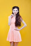 Fashion asian young  girl. Portrait on yellow Royalty Free Stock Image