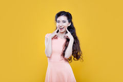 Fashion asian young  girl. Portrait on yellow Royalty Free Stock Photos