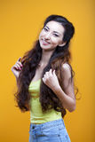 Fashion asian young  girl. Portrait on yellow Royalty Free Stock Images