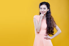 Fashion asian young  girl. Portrait on yellow Royalty Free Stock Photography