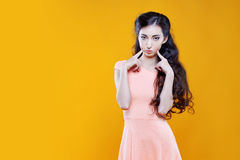 Fashion asian young  girl. Portrait on yellow background. Fashion asian young  girl. Portrait on the yellow background Royalty Free Stock Photo