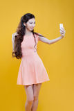 Fashion asian young  girl   taking picture of Royalty Free Stock Photo