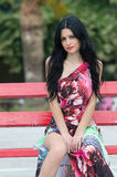 Fashion attractive lady with flowered long red dress Stock Photography