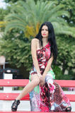 Fashion attractive lady with flowered long red dress Stock Images