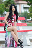 Fashion attractive lady with flowered long red dress Royalty Free Stock Image