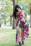 Fashion attractive lady with flowered long red dress Royalty Free Stock Photos