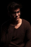 Fashion attractive young man with glasses looking away Royalty Free Stock Images
