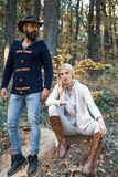 Fashion autumn couple on fall nature background. Autumn love story - portrait couple in love. Autumnal mood. Enjoying. Nice weekend together. Autumn fashion royalty free stock photography