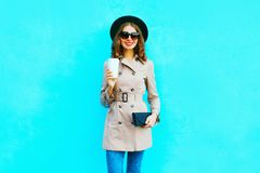 Fashion autumn look. smiling woman holds coffee cup royalty free stock photos