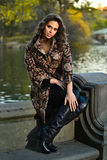 Fashion autumn outdoor photo of sexy beautiful woman posing near the lake in the park. Royalty Free Stock Image
