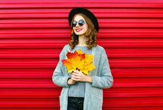 Fashion autumn portrait smiling woman with yellow maple leaves Royalty Free Stock Photos
