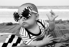 Fashion baby. On the seaside royalty free stock photography