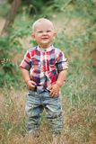 Fashion baby boy walking in grass Stock Photography