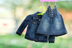 Fashion baby  denim dress with  jacket  hanging on a hanger Stock Images