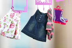 Fashion baby dresses hanging on a hanger Royalty Free Stock Images