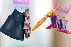 Fashion baby dresses hanging on a hanger on a green  background Stock Image