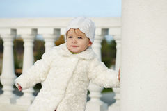 Fashion baby girl. Wearing fur coat royalty free stock photography