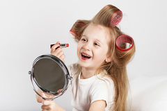 Fashion baby girl is doing makeup and having fun Stock Photo