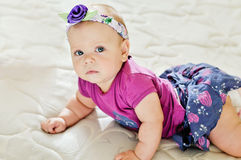 Fashion baby. Girl looking in camera royalty free stock photos
