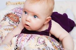 Fashion baby girl lying Stock Photos