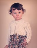 Fashion baby girl posing in modern Royalty Free Stock Photography
