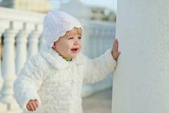 Fashion baby. Girl wearing white clothing royalty free stock image