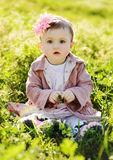 Fashion baby in grass Royalty Free Stock Image