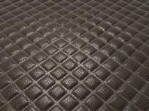Fashion background: Alligator stitched black skin. With square shapes Stock Photography
