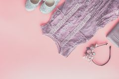 Fashion background in pink. Girls` fashion background in pastel colors, lace dress, sparkly shoes, flower headband, flat lay, top view, toned photo, copy space royalty free stock photos