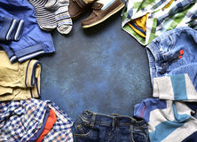 Fashion background with set of baby clothes.Top view with copy s Royalty Free Stock Images