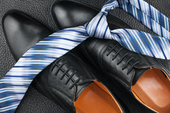 Fashion background of shoes and tie Royalty Free Stock Photos