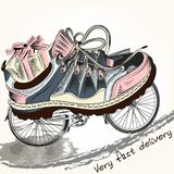 Fashion background with sports boots on a bike wheels symbolized Stock Photography