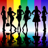 Fashion background with young ladies silhouettes Stock Images