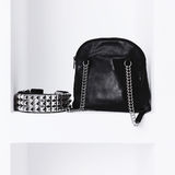Fashion bag and belt on the shelf in white interior. Royalty Free Stock Image