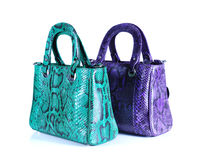 Fashion bags animals skins on background Royalty Free Stock Images