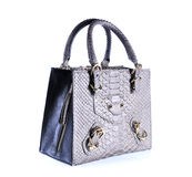 Fashion bags animals skins on background Royalty Free Stock Photos