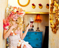 Fashion baroque blond womand drinking red wine Stock Images