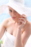 Fashion at the beach ­ beautiful woman in costume Stock Photos
