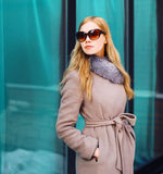 Fashion beautiful blonde woman wearing coat jacket and sunglasses in city Royalty Free Stock Photography