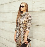 Fashion beautiful blonde woman wearing a leopard dress Stock Photo