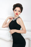 Fashion beautiful brunette girl model in black dress posing  Royalty Free Stock Images