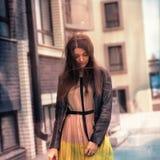 Fashion beautiful brunette woman wearing a rock black leather Stock Photo
