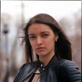 Fashion beautiful brunette woman wearing a rock black leather Royalty Free Stock Image